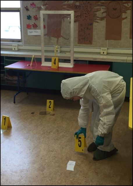CSI member placing evidence number markers
